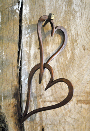 Medium size dark copper finish forged linked hearts